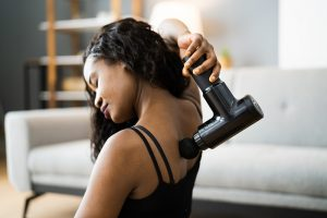Massage Guns produce percussive vibrations helping relax muscles relieve trigger points & decrease pain.